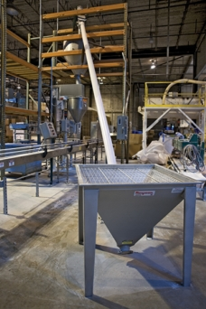APCO Packaging Moves Perlite in Low Headroom Area with Flexible Screw Conveyor