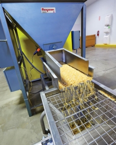 Brittle Pasta Handled Gently, Automatically with Box Dumpers, Tubular Cable Conveyors