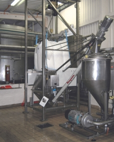 Dust-Tight Bulk Bag Discharger with Flexible Screw Conveyor Eliminates Waste, Improves Safety and Quality